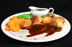 Roast Pork Dinner with Gravy Royalty Free Stock Photos