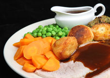 Roast Pork Dinner with Gravy. Roast pork dinner with individual gravy boat Stock Photos