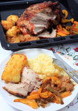 Roast pork dinner with joint Royalty Free Stock Photos