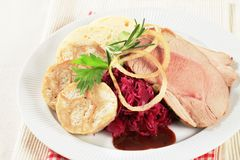 Roast pork, dumplings and red cabbage Stock Image