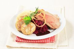 Roast pork, dumplings and red cabbage Royalty Free Stock Photo