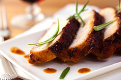 Roast pork with fresh rosemary Royalty Free Stock Photography