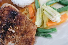 Roast pork with with garlic on top and vegetable side dish. Pork Plate with Vegetables Royalty Free Stock Image