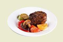 Roast pork with grilled vegetables Stock Images