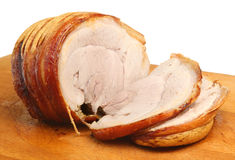 Roast Pork Joint. Resting on a carving board stock images