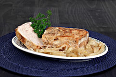 Roast pork loin and onions. Royalty Free Stock Image