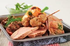Roast pork meat in a baking pan Stock Photos