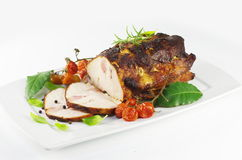Roast pork meat. On white plate Royalty Free Stock Image