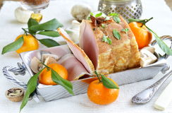 Roast pork with mushrooms and tangerines Stock Image