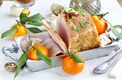 Roast pork with mushrooms and tangerines Stock Image