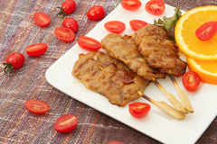 Roast pork with red tomato Stock Images