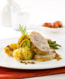 Roast pork with potatoes Stock Photo
