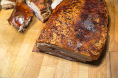 Roast Pork. Ready to be cut on wooden board Royalty Free Stock Images