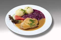 Roast pork with red cabbage and potato dumpling and sauce Royalty Free Stock Photography