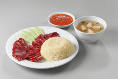 Roast pork rice. A plate of delicious roasted pork rice with soup and chili Royalty Free Stock Image