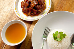 Roast pork with rice and soup. Stock Photos