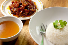 Roast pork with rice and soup. Stock Photo