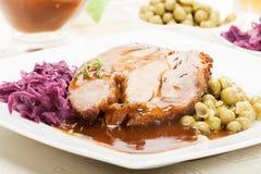 Roast pork with sauce Stock Image
