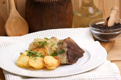 Roast pork with sauerkraut and potato Stock Photos