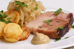 Roast pork with  sauerkraut and potato Royalty Free Stock Photo
