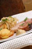 Roast pork with sauerkraut and potato Stock Image