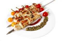 Roast pork shish kebab on white Stock Image