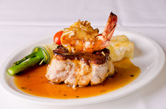 Roast pork and shrimp dish Stock Photos