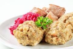 Roast pork with Tyrolean dumplings and red cabbage Royalty Free Stock Photo