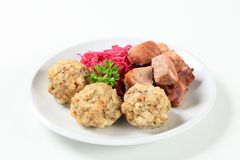 Roast pork with Tyrolean dumplings and red cabbage Royalty Free Stock Photos