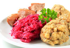 Roast pork with Tyrolean dumplings and red cabbage Royalty Free Stock Photography