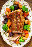 Roast pork with vegetables stock image