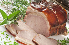 A roast pork on white Royalty Free Stock Images