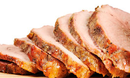 Roast pork on a wooden board Stock Photos