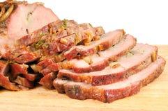 Roast pork on a wooden board Stock Image