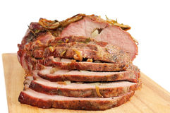 Roast pork on a wooden board Stock Photo