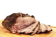 Roast pork on a wooden board Stock Photos
