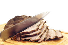 Roast pork on a wooden board Royalty Free Stock Photos