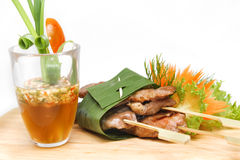 Roast pork wrapped in banana leaves Stock Photo