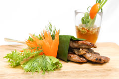 Roast pork wrapped in banana leaves Stock Images