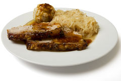 Roast port with pickled cabbage and dumpling Stock Images