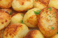 Roast Potatoes. Crunchy roast potatoes seasoned with sea salt and freshly ground pepper stock images