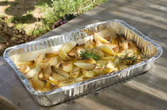Roast potatoes. Tin of baked potatoes and flavored with rosemary Stock Photography