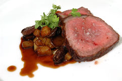 Roast and potatoes. Pot roast with potatoes and mushrooms stock images