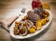 Roast with potatoes and apple royalty free stock photos