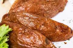 Roast potatoes as a garnish for beef steak. Royalty Free Stock Photography