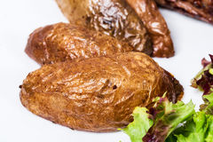Roast potatoes as a garnish for beef steak. Stock Photography
