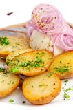 Roast potatoes with hering and onion Stock Images
