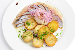 Roast potatoes with hering and onion Royalty Free Stock Image
