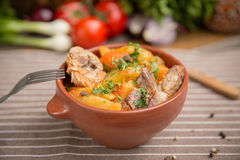 Roast potatoes and pork ribs. Rustic dish Royalty Free Stock Images