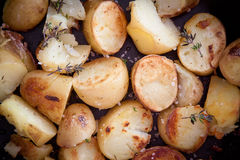 Roast potatoes with thyme. Just out of the oven, detail Royalty Free Stock Photography